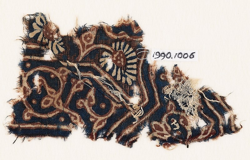 Textile fragment with curving tendril, leaves, and a flower (EA1990.1006, front             )