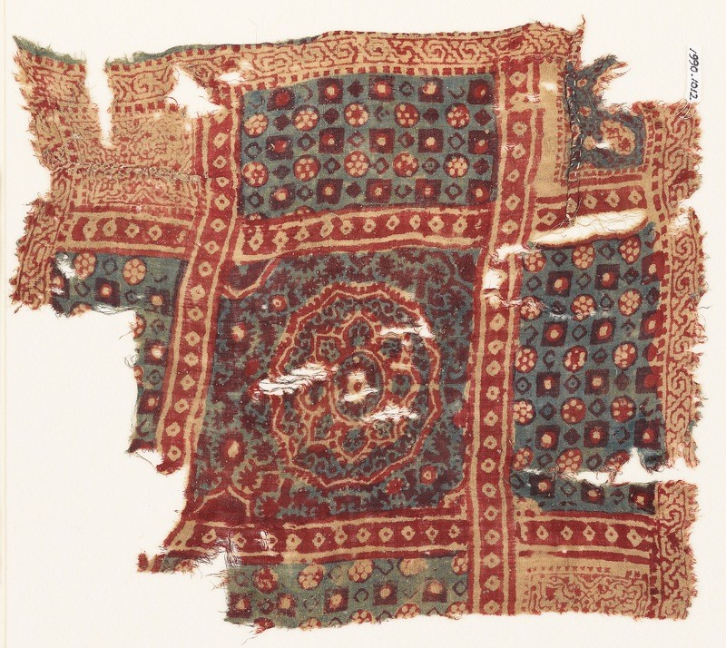 Textile fragment with large medallion, squares, and rosettes