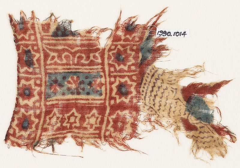 Textile fragment with stars, rosette, and crosses