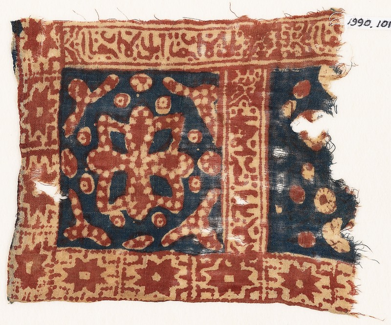 Textile fragment with square, a flower, stars, and Arabic inscription (front             )