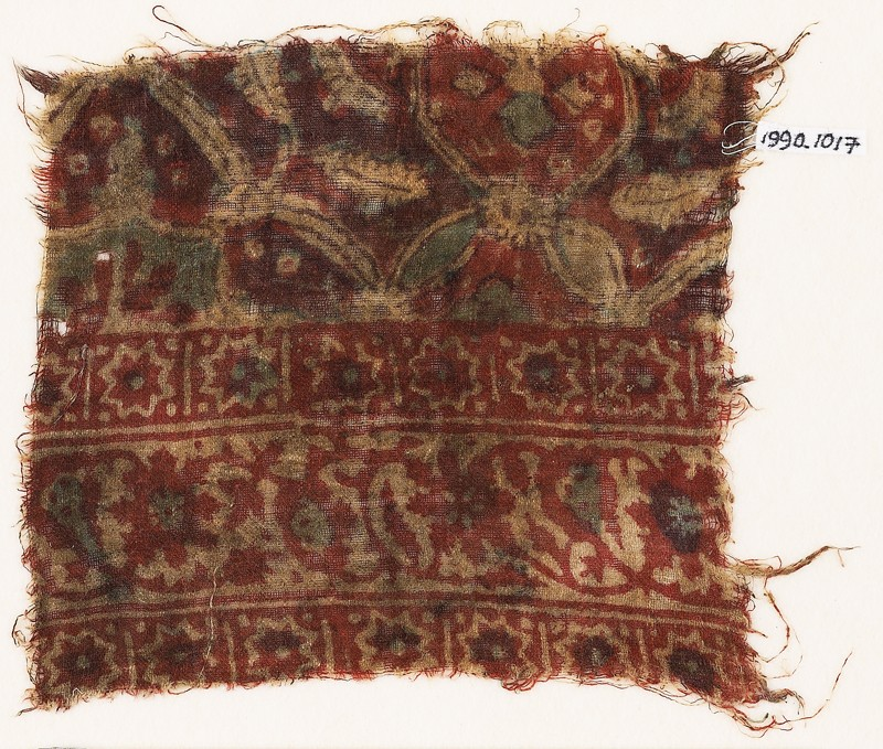 Textile fragment with stars, interlace, and possibly linked medallions
