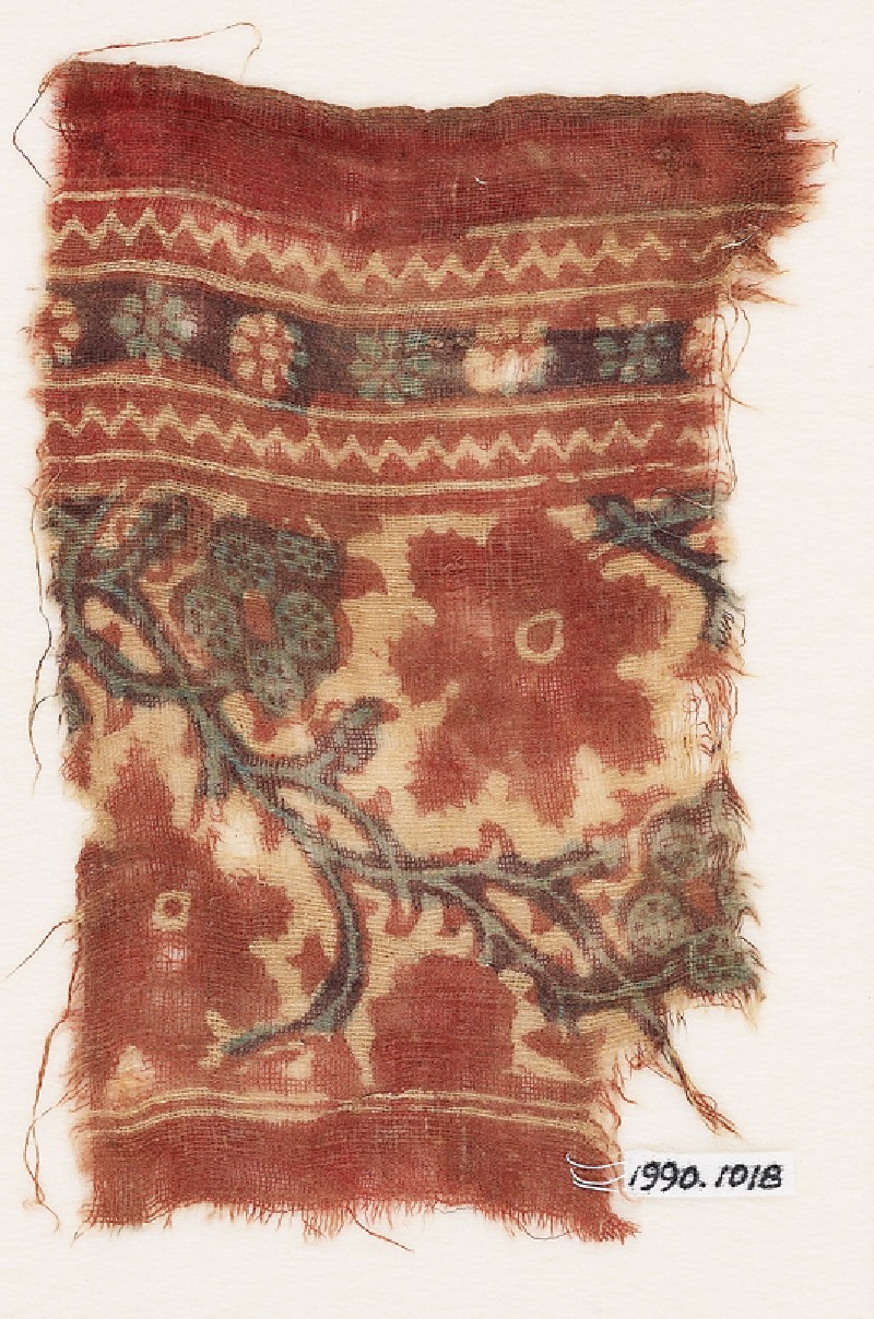 Textile fragment with tendrils, vine leaves, and flowers or fruit