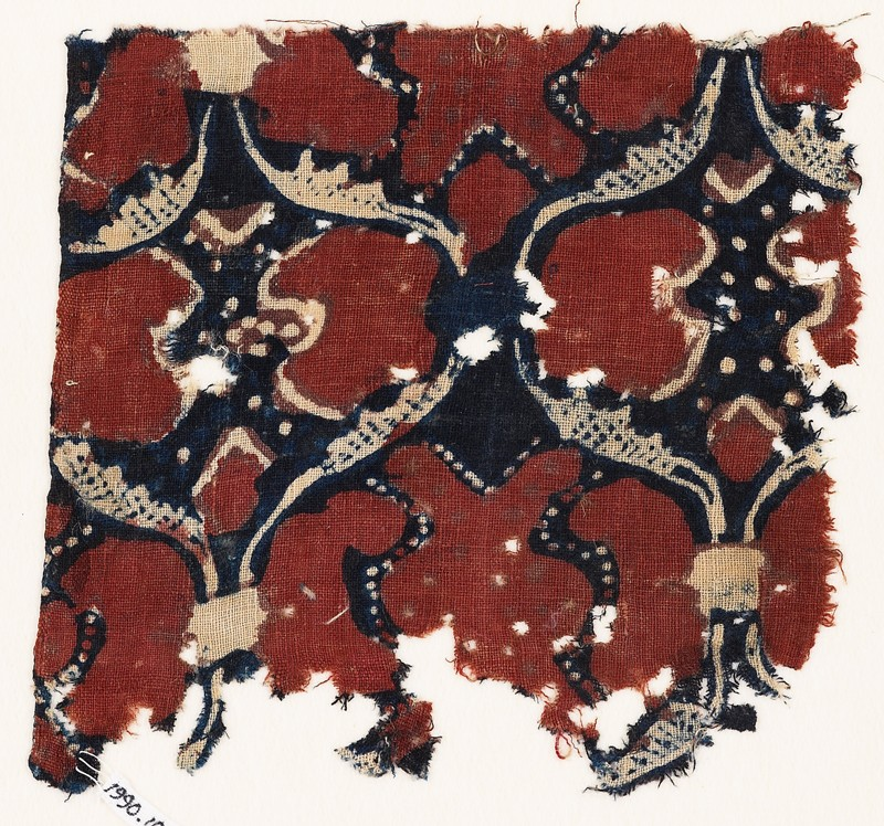 Textile fragment with linked oval medallions