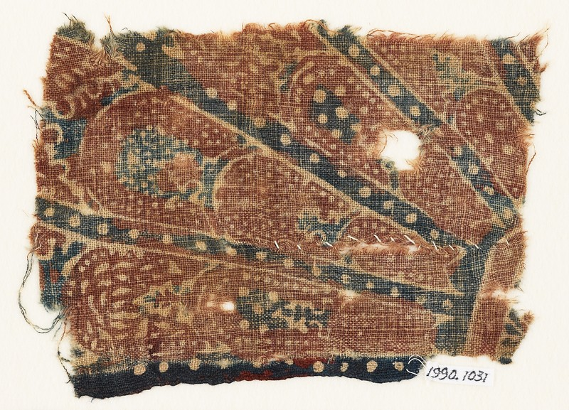Textile fragment with part of a large rosette medallion