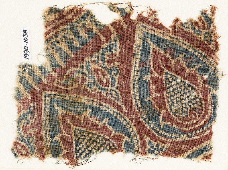 Textile fragment with tear-drops and leaves