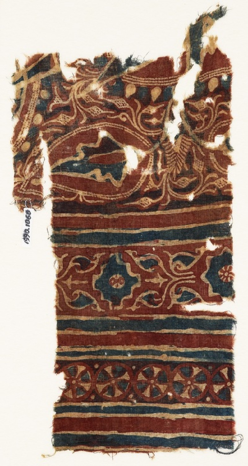 Textile fragment with leaves, a stepped square, and wheels