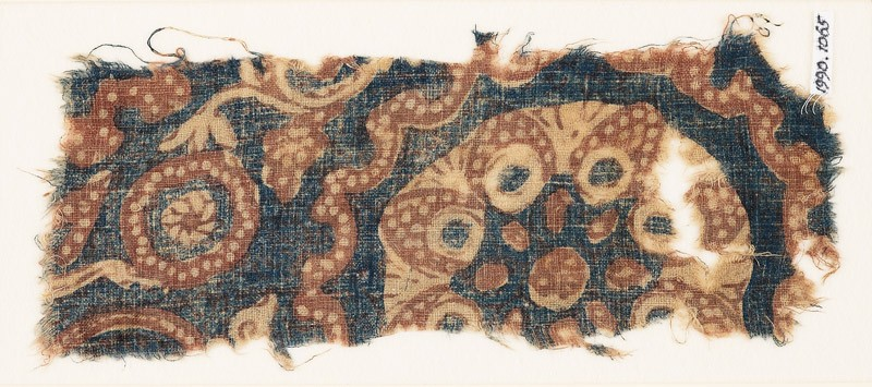Textile fragment with tendrils, circles, and flower