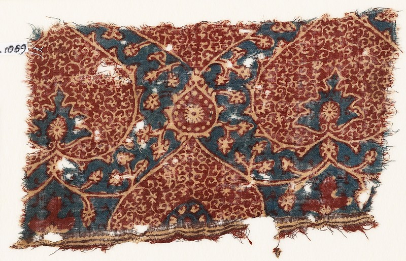 Textile fragment with heart-shaped leaves and tendrils