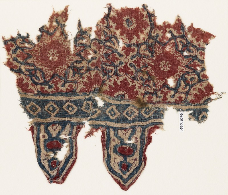 Textile fragment with medallions, interlace, and tabs