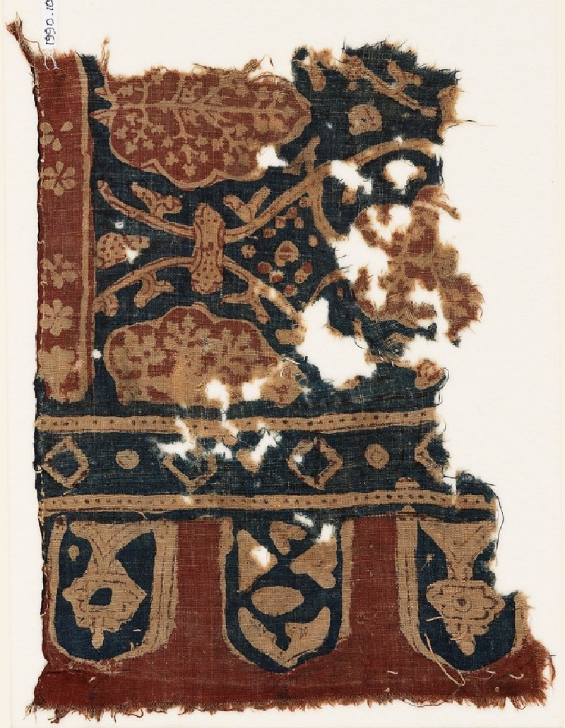 Textile fragment with linked tendrils, stylized trees, and tabs (front             )