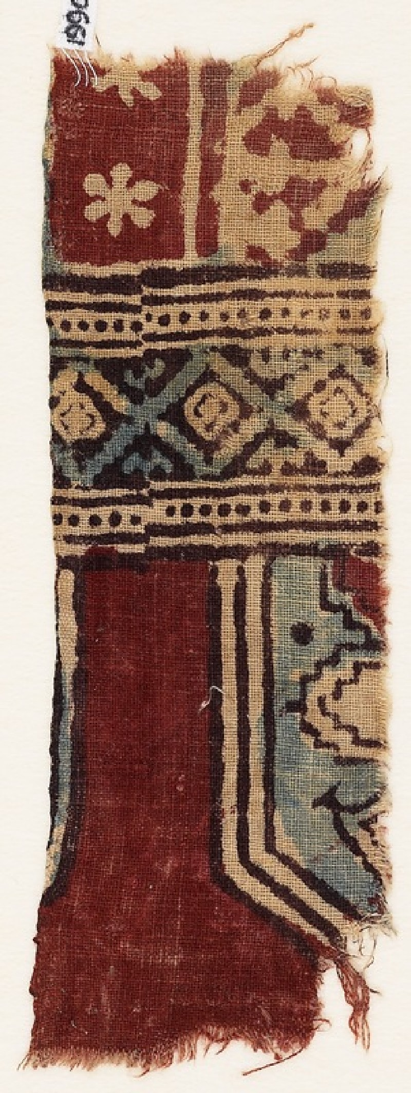 Textile fragment with part of a tab, cartouche, and plant