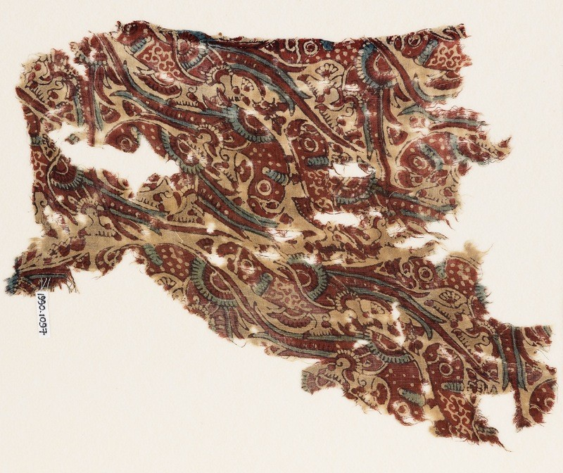 Textile fragment from a garment with parrots