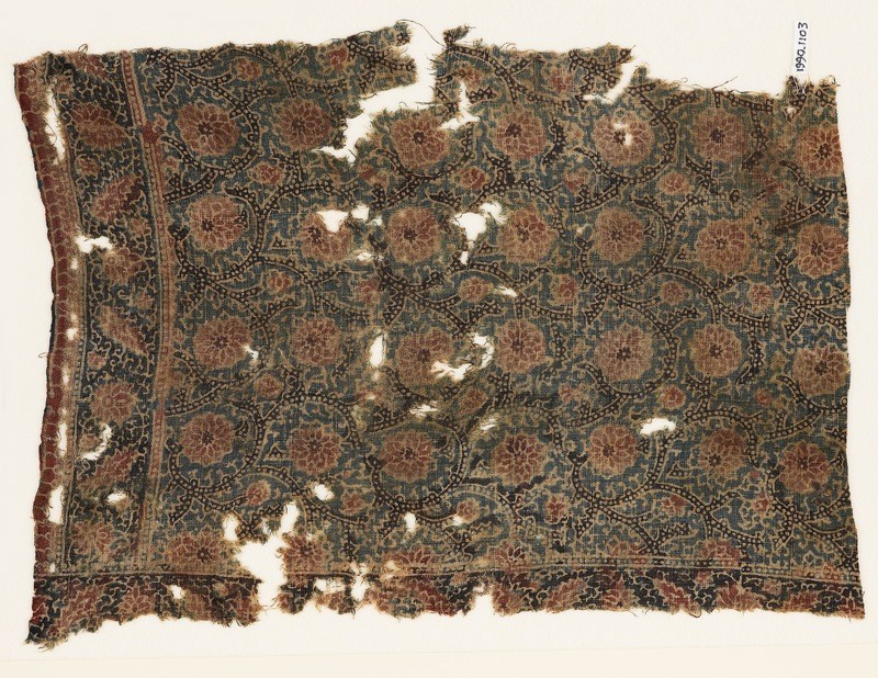 Textile fragment with flower-heads and tendrils