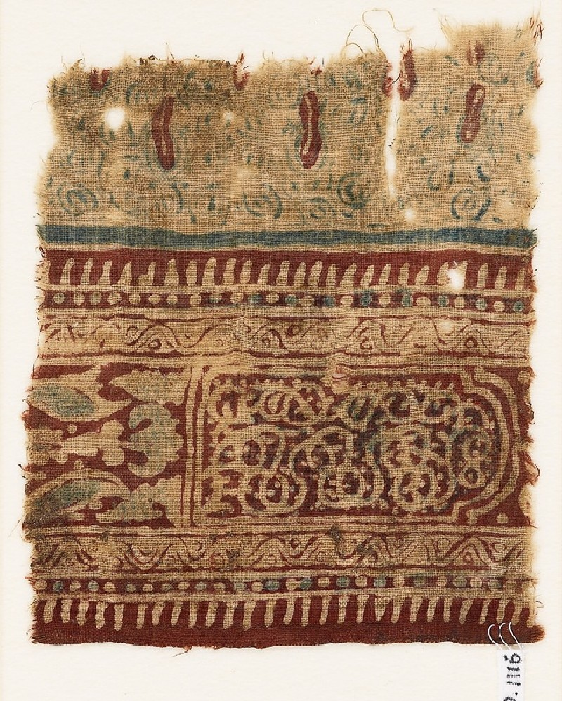 Textile fragment with stylized plants, a cartouche, and interlace (front             )