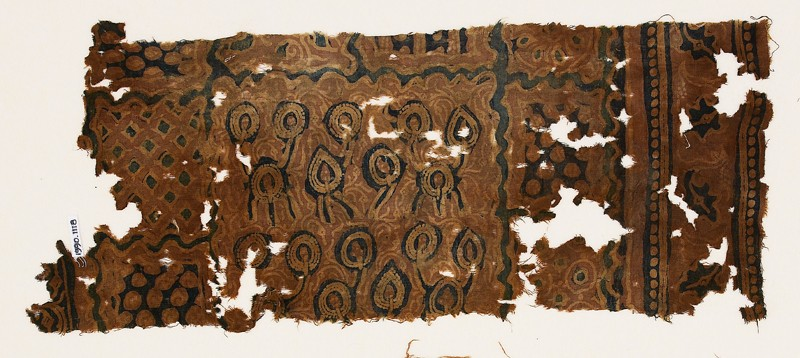 Textile fragment with stylized plants and tendrils