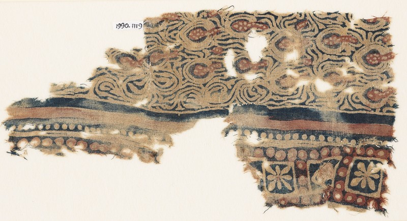 Textile fragment with stylized plants and squares