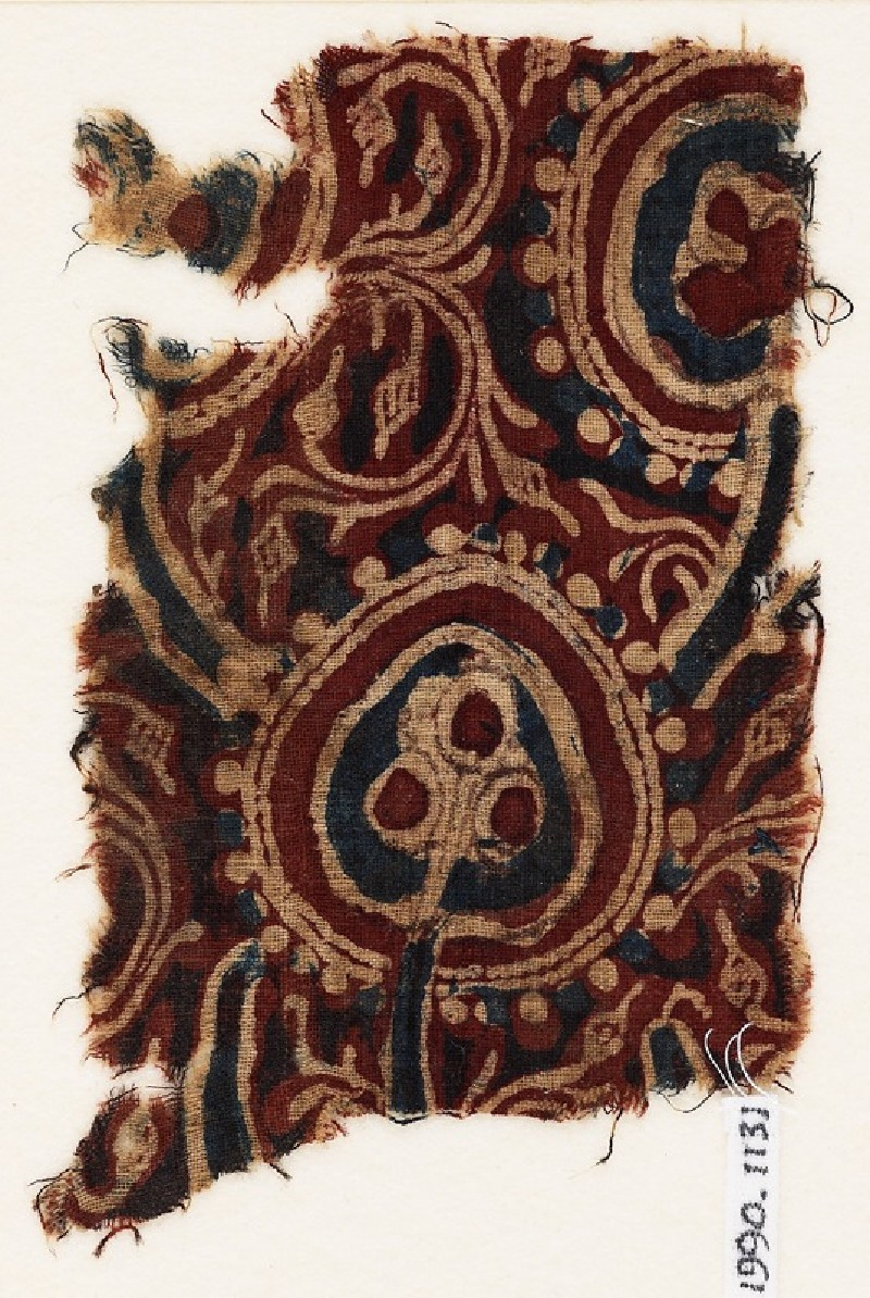 Textile fragment with stylized trees, and fruits or flowers