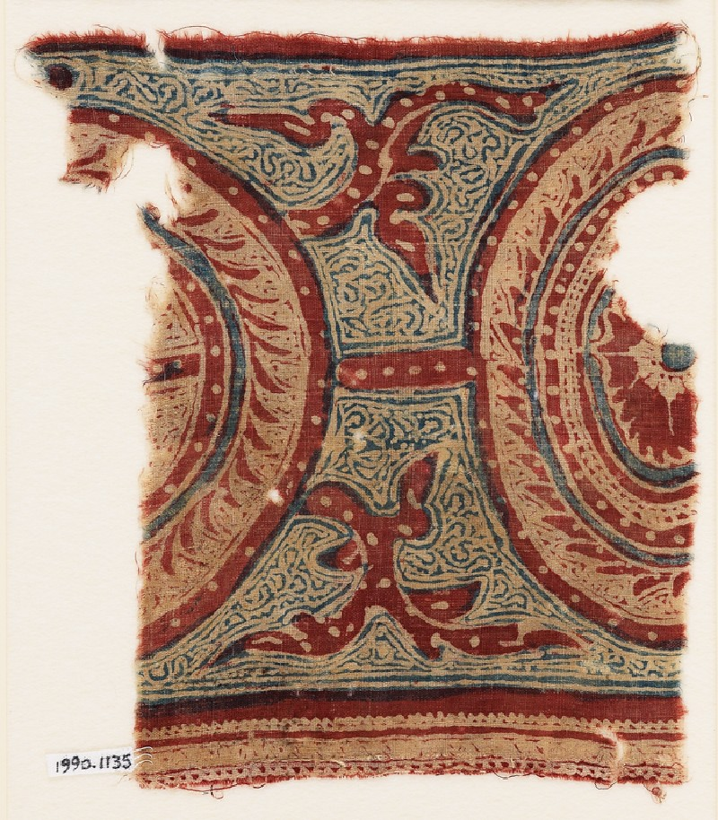 Textile fragment with two linked medallions and tendrils
