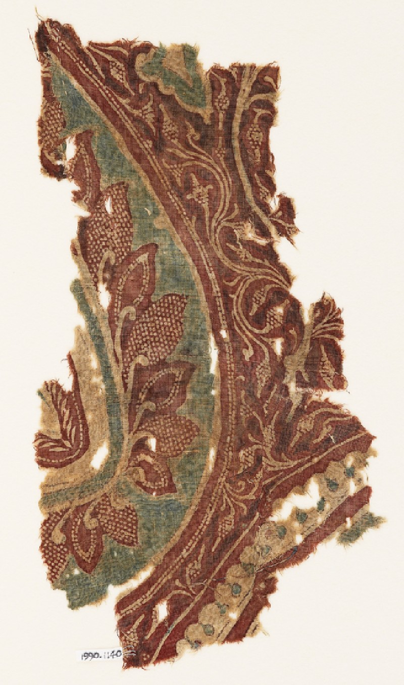 Textile fragment with part of a large leaf, tendrils, and bunches of fruit (EA1990.1140, front             )