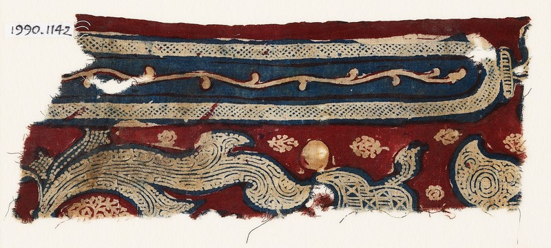 Textile fragment with cross-hatched frame and leaves (front             )