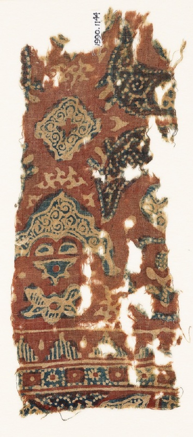 Textile fragment with crescents, square, and tendrils