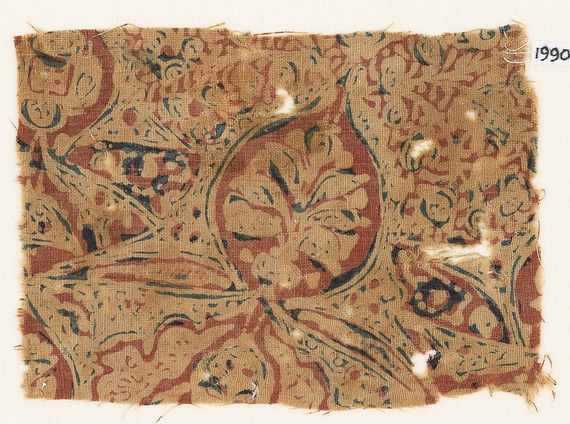 Textile fragment with medallion and plant