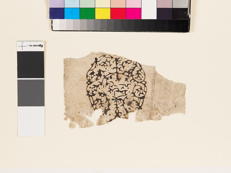 Paper fragment with circular design and inscription (EA1990.1232, front             )