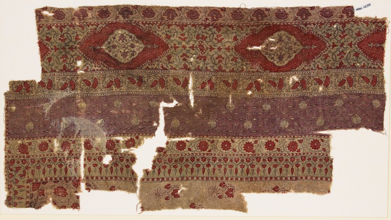 Textile fragment with bands of carnations, grapes, and flower-heads