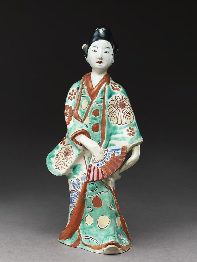 Figure of dancing woman (side             )