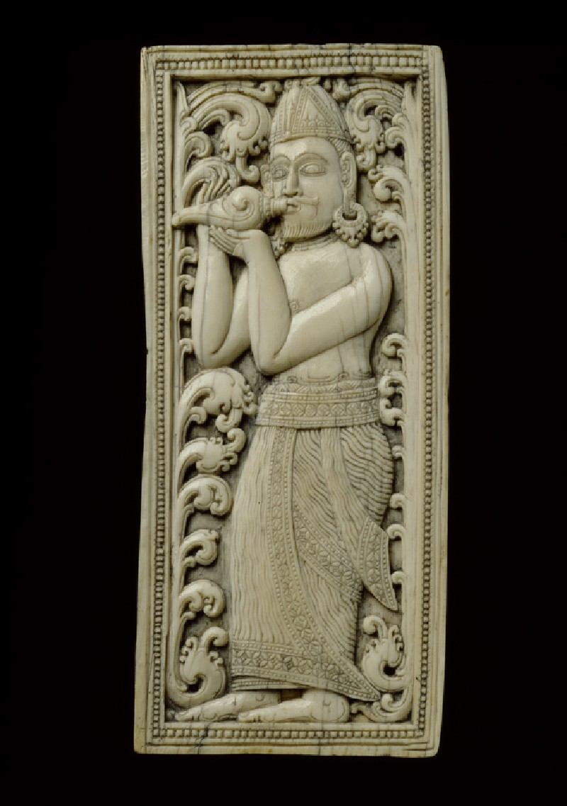 Ivory plaque with conch-blower (front             )