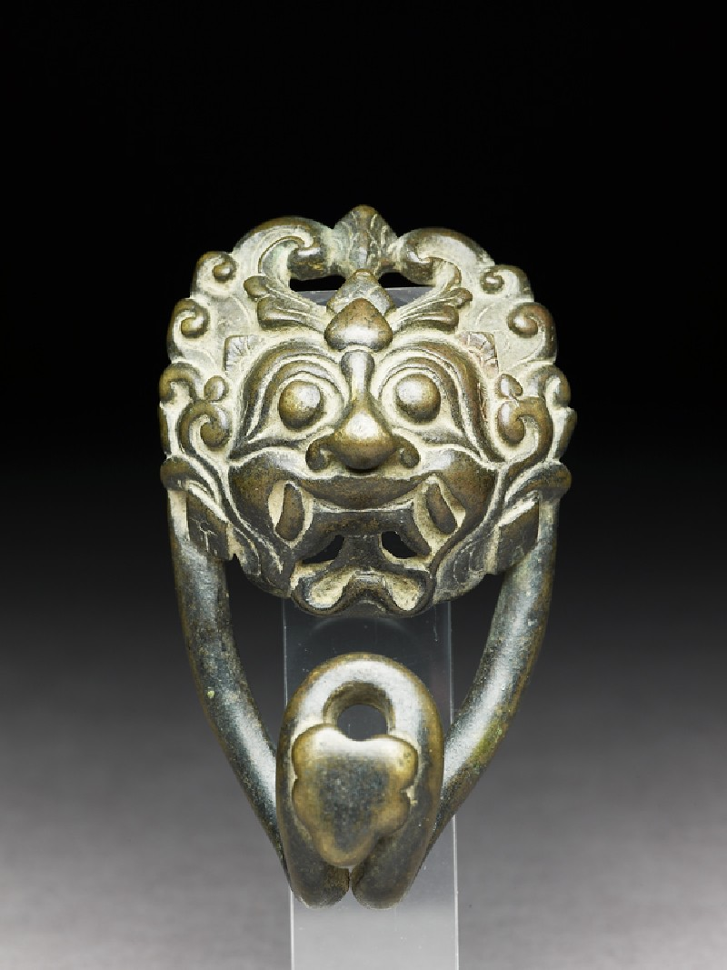 Bronze belt clasp with demon face