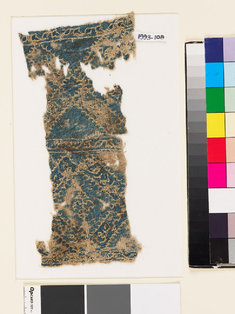 Textile fragment with diamond-shapes and floral patterns