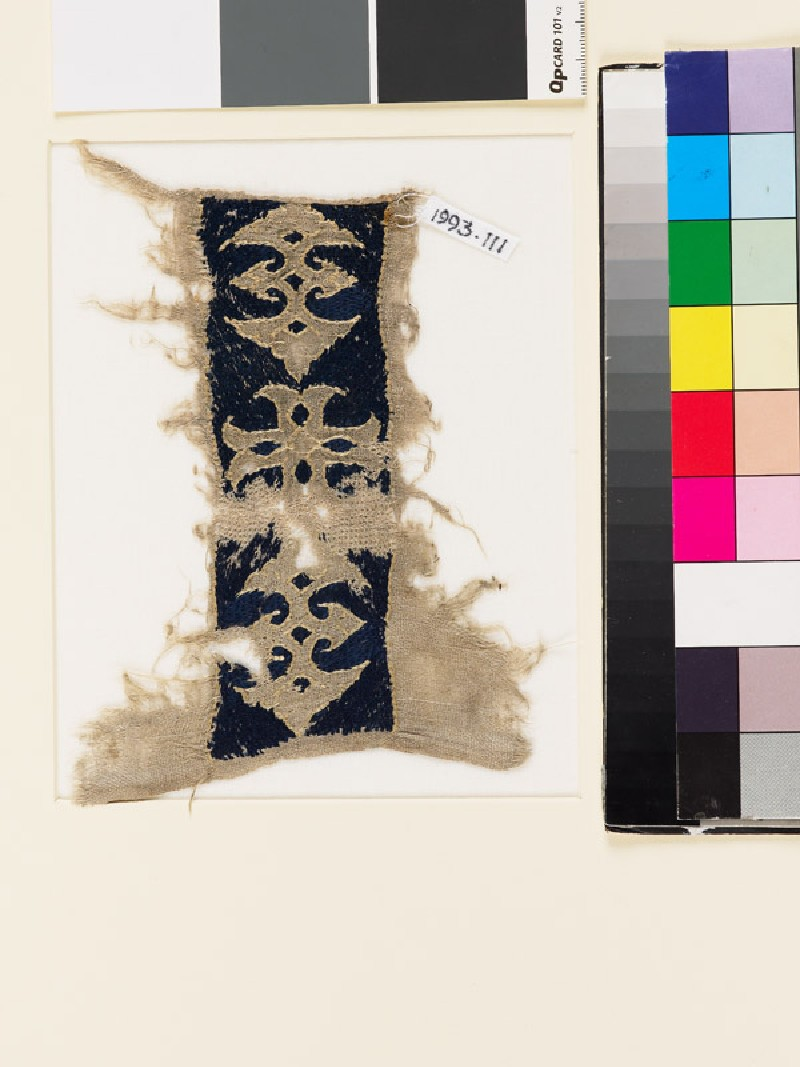 Textile fragment with cross and double palmettes (EA1993.111, front            )