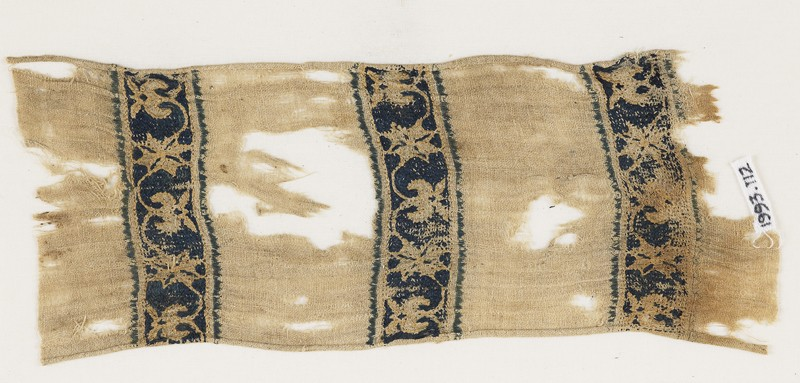 Textile from a scarf or girdle with scrolling tendrils and flowers