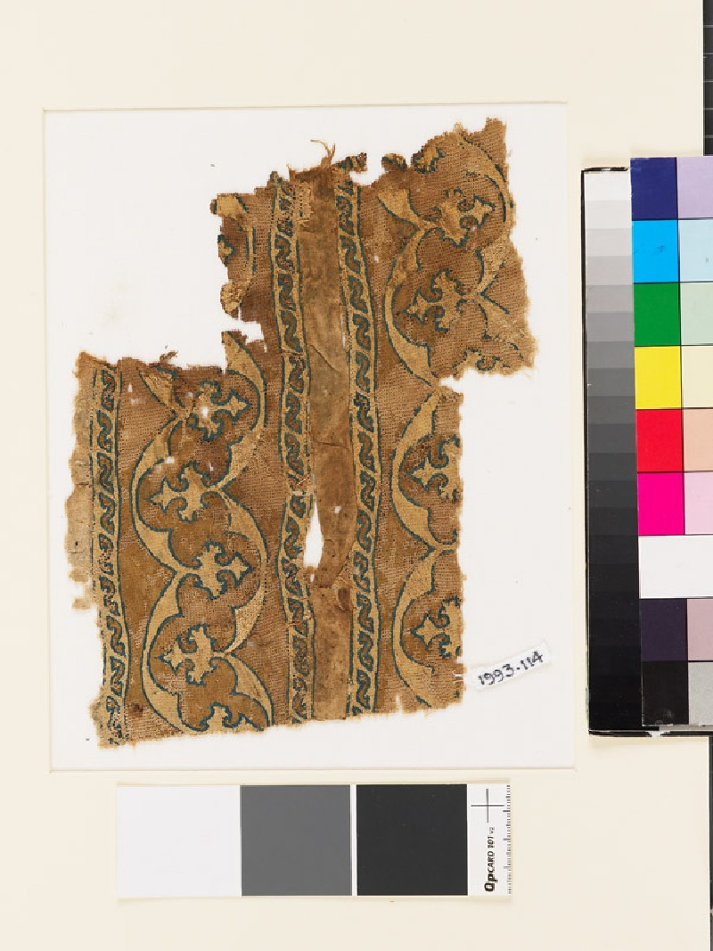 Textile fragment with bands of curving lines and floral trefoils (EA1993.114, front            )
