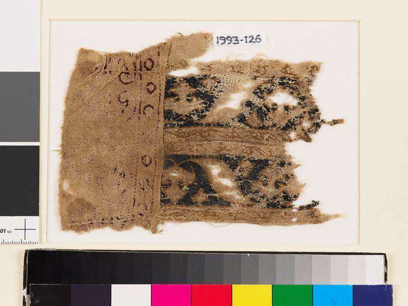 Textile fragment with bands of palmettes and leaves