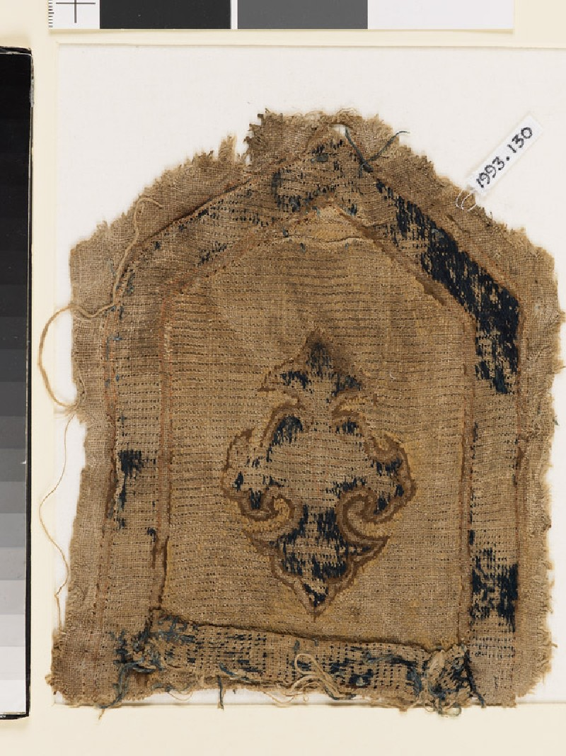 Textile fragment with elaborate cross (front            )