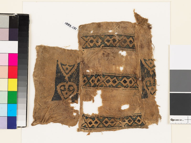 Textile fragment with bands of diamond-shapes and hearts
