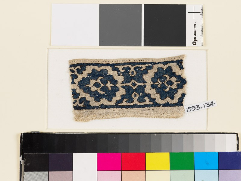 Textile fragment with paired palmettes and octagons (front            )