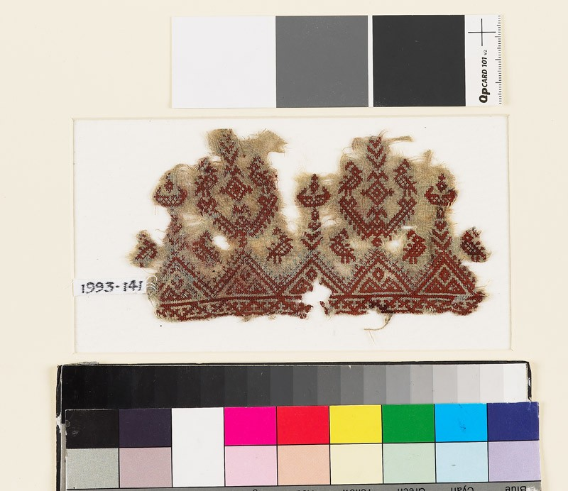 Textile fragment with stylized trees and birds