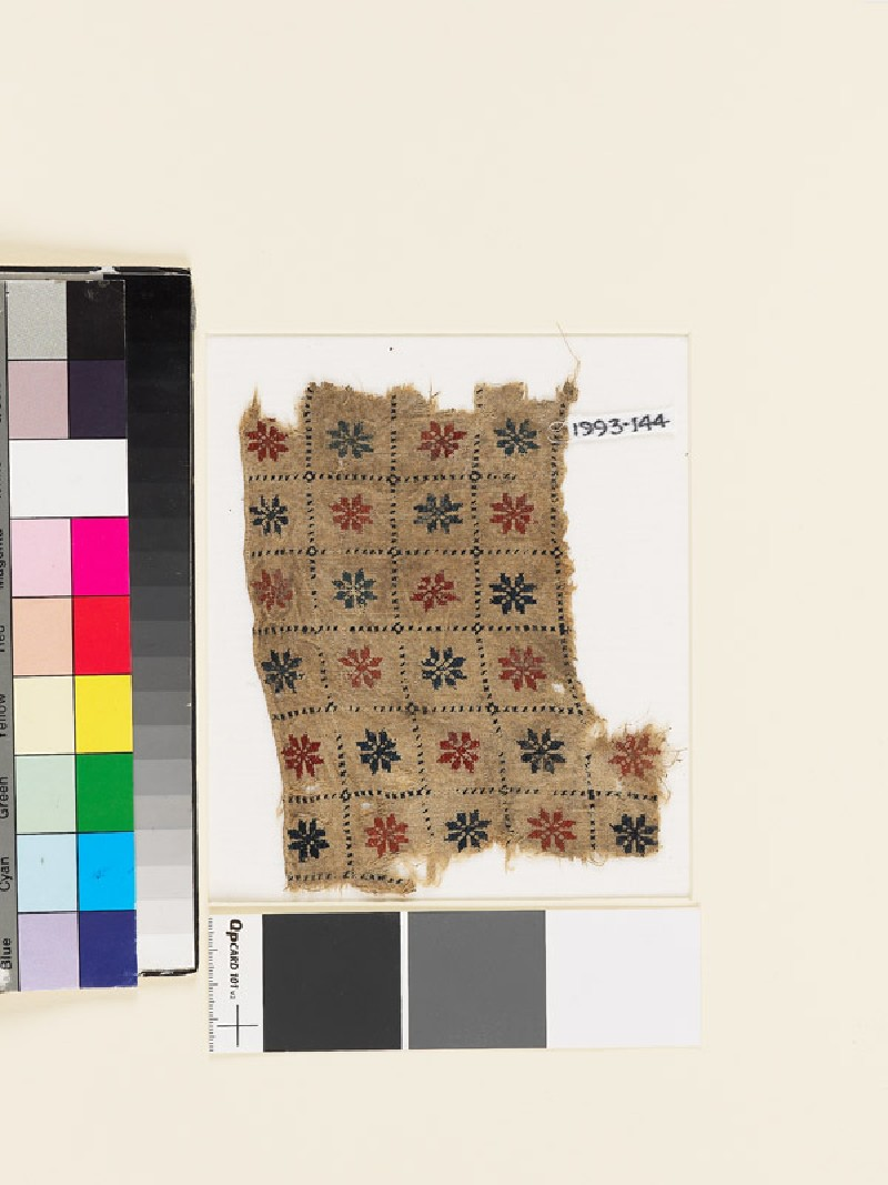 Textile fragment with grid of rosettes