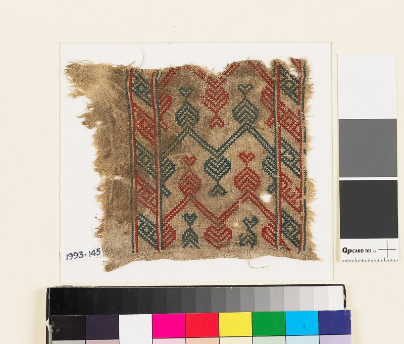 Textile fragment with hearts, V-shapes, and chevrons