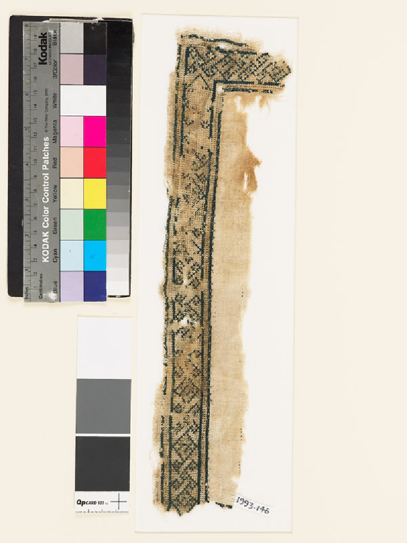 Textile fragment with geometric shapes, diamond-shapes, and crosses (EA1993.146, front            )