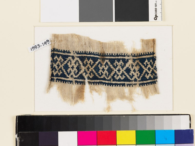 Textile fragment with double diamond-shapes and crosses
