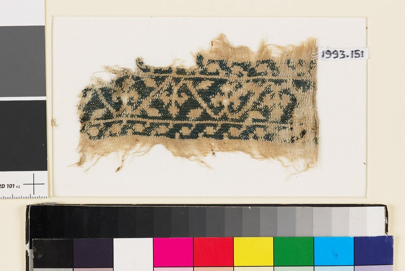 Textile fragment from a belt or scarf with trefoils and leaves (EA1993.151, front            )