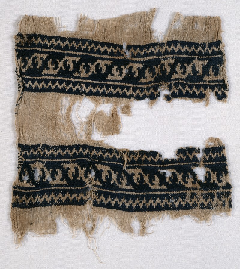 Textile from a scarf or girdle with leaves and chevrons (front            )
