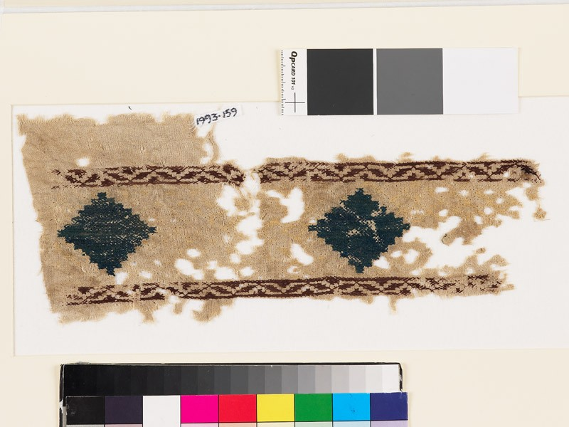 Textile fragment with stepped diamond-shapes and lattice