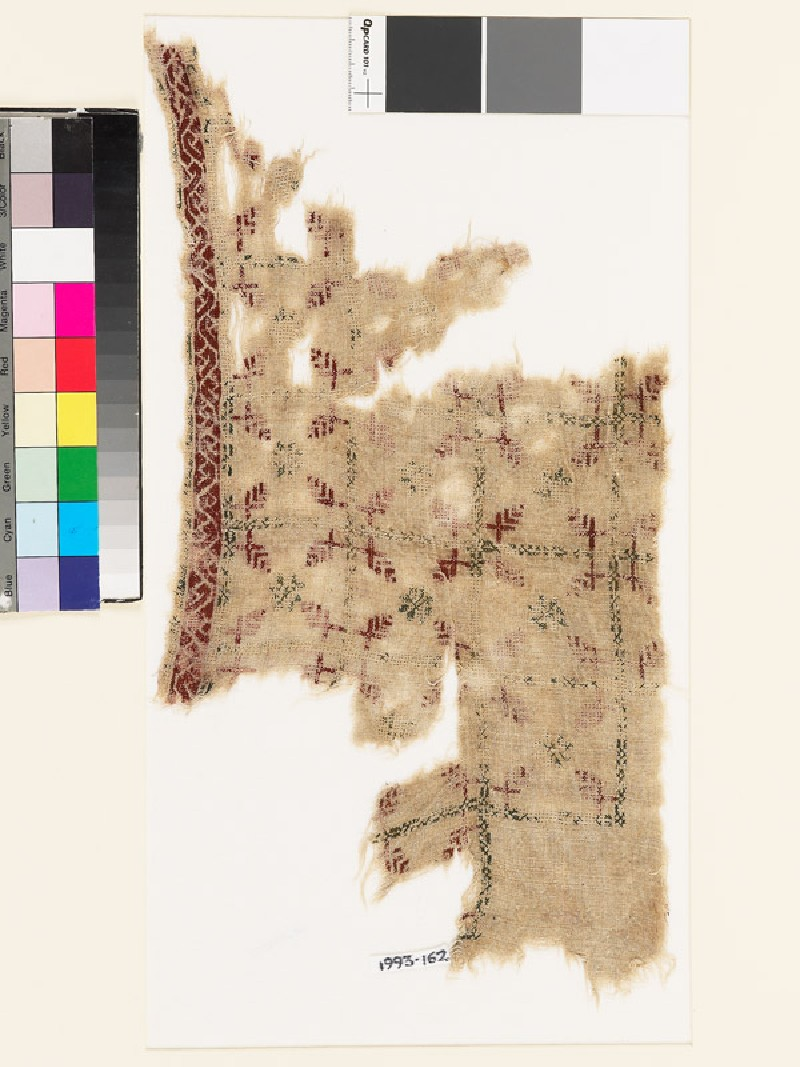 Textile fragment with grid of squares, rosettes, and leaves (front            )