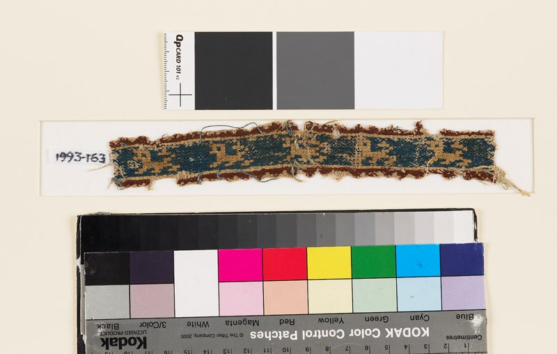 Textile fragment with five lions