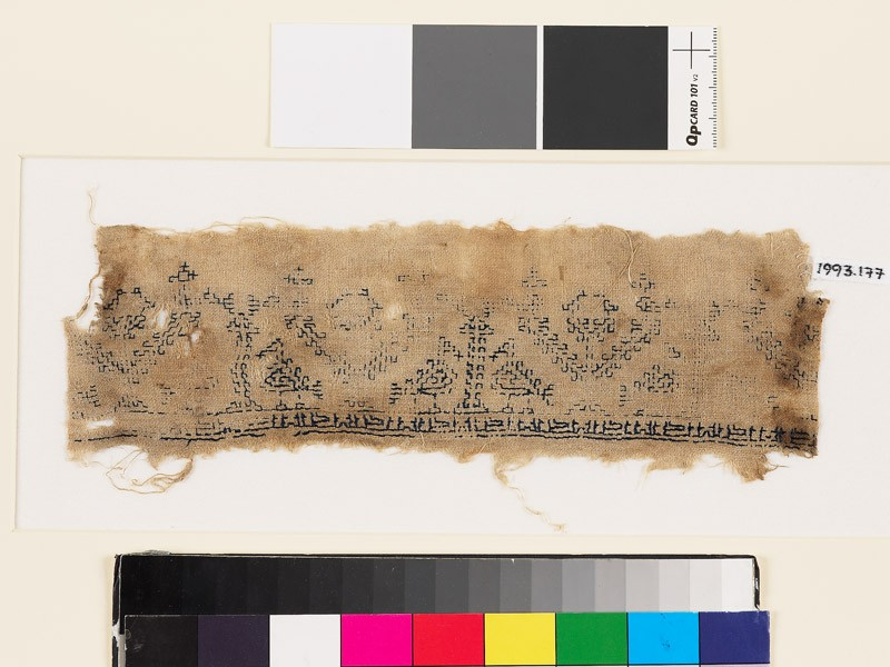 Textile fragment with stylized pairs of birds, trees, and pseudo-kufic inscription (EA1993.177, front            )